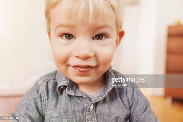 Portrait of toddler outstretching his tongue