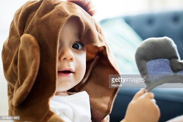 portrait of toddler wearing cap at home - brown hat stock photos and pictures