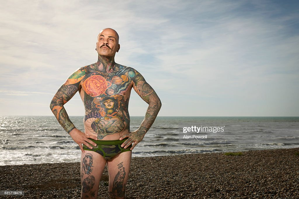 Portrait of topless man with Tattoos : Stock Photo