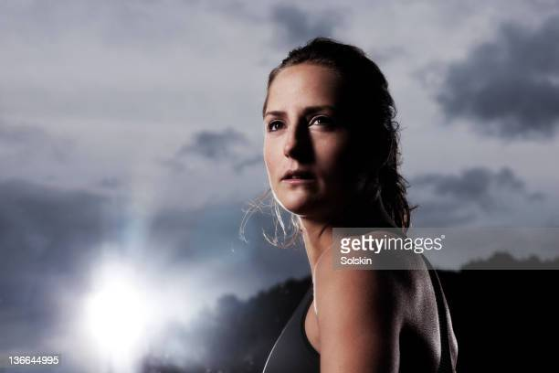portrait of track and field athlete - forward athlete stock pictures, royalty-free photos & images