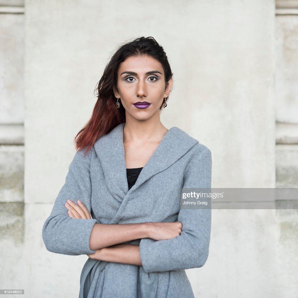 Portrait of transgender female facing camera, arms folded : Stock-Foto