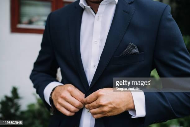 portrait of trendy, attractive, stunning man. - smoking pak stockfoto's en -beelden