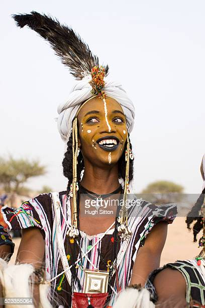 portrait of tribal man in traditional clothing and face paint - african tribal face painting stock photos and pictures