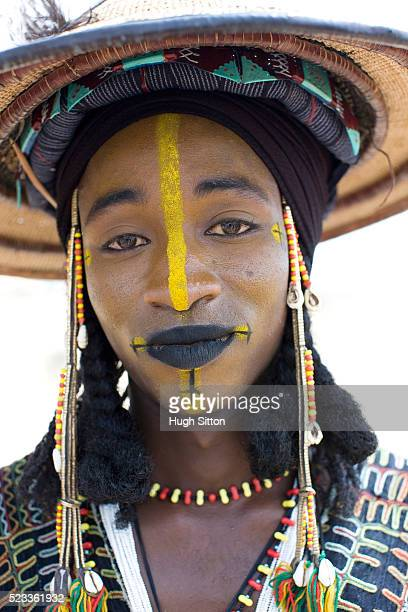 portrait of tribal man in traditional clothing and face paint - hugh sitton stock pictures, royalty-free photos & images