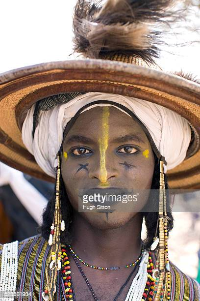 Portrait of tribal man in traditional clothing and face paint
