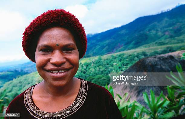 portrait of trukat village woman with house in background. - papua new guinea stock pictures, royalty-free photos & images
