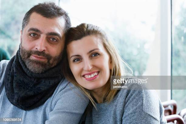 Portrait of Turkish couple smiling at cafe
