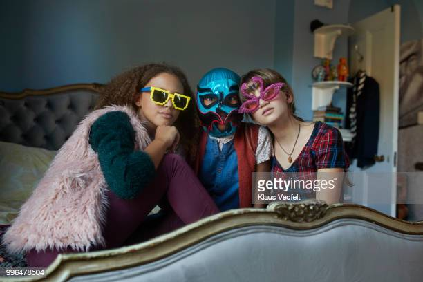 Portrait of tween friends wearing weird glasses and Mexican wrestler mask