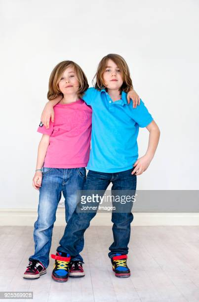 portrait of twin brothers - legs apart stock pictures, royalty-free photos & images