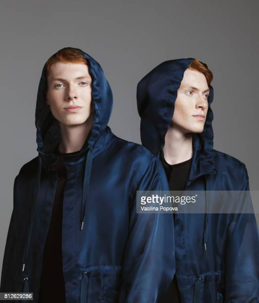 portrait of twins - identical twin stock pictures, royalty-free photos & images