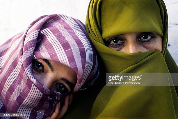 Portrait of two Afghan women wearing hijabs