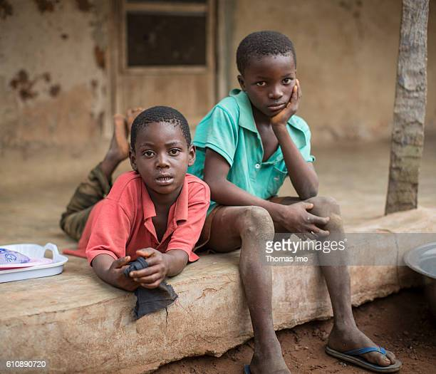 Portrait of two African children in front of a hut on a cashew farm on September 06 2016 in Congo Ghana
