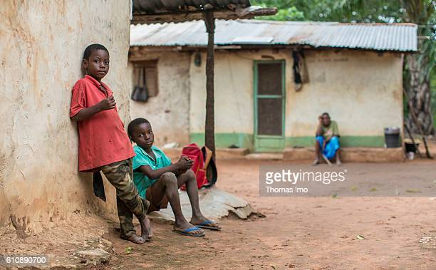 Portrait of two African children in front of a hut on a cashew plantation on September 06 2016 in Congo Ghana