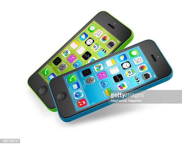 Portrait of two Apple iPhone 5C smartphones photographed on a white background taken on September 20 2013