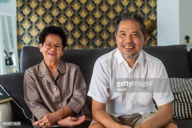 Portrait of Two Asian Grandparents at Home