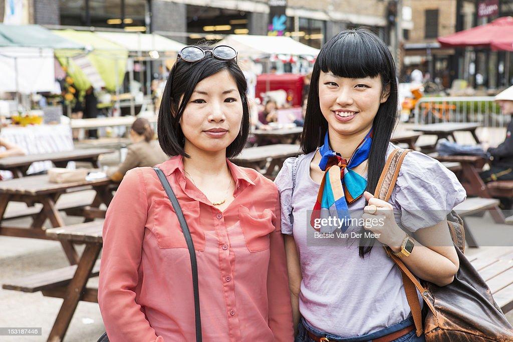 Portrait of two asian women at urban market. : Stock Photo