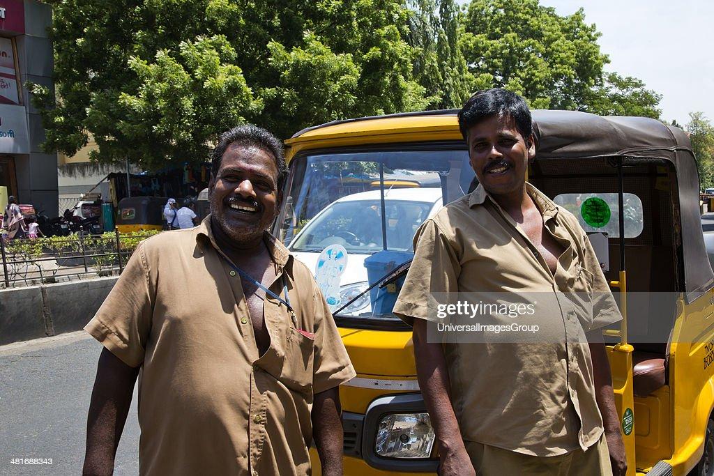 Portrait of two auto rickshaw drivers smiling, Chennai, Tamil Nadu