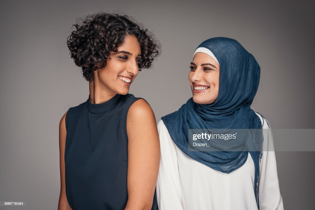 Portrait of two beautiful women from Middle East who live and work in Australia : Stock Photo