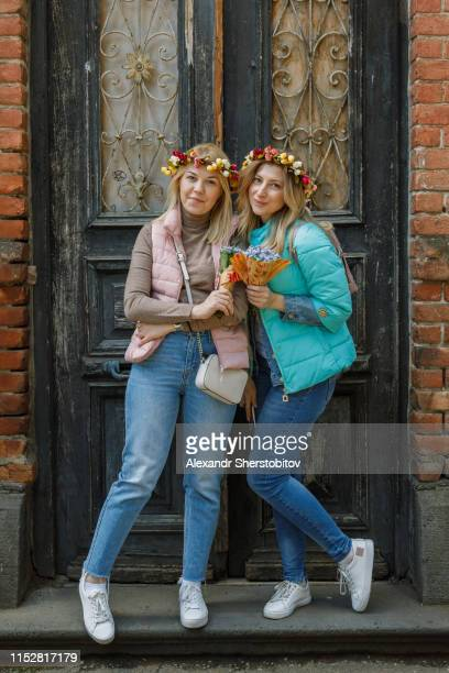 Portrait of two beautiful women with bouquets