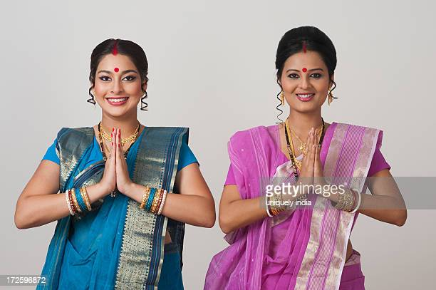 Portrait of two Bengali women greeting and smiling