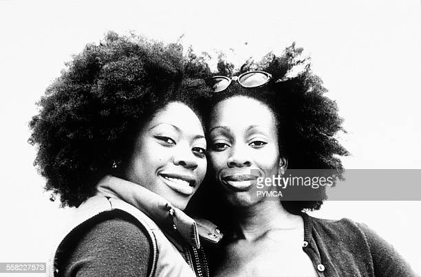 Portrait of two black women with large afros UK 1990s