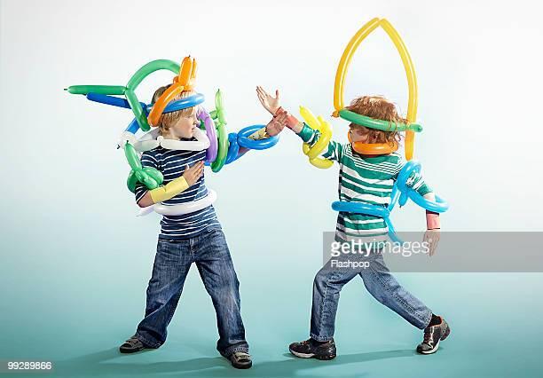 Portrait of two boys playing in fancy dress