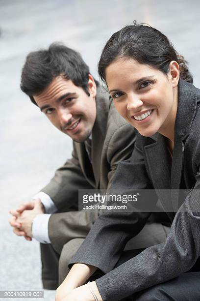portrait of two business executives smiling - side by side stock photos and pictures