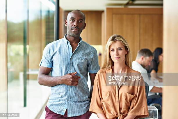 portrait of two business people in modern office - bedfordshire stock photos and pictures