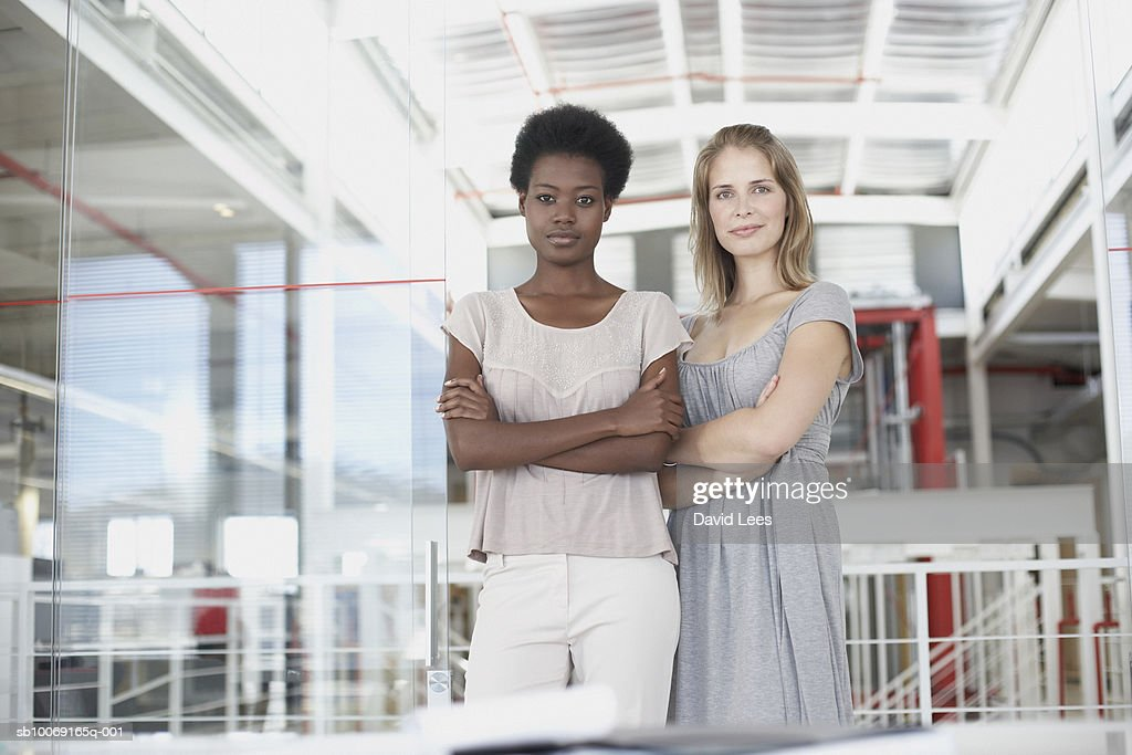 Portrait of two business women in lobby : Stockfoto