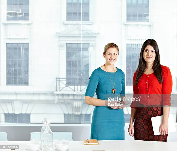 Portrait of two business women in modern office.