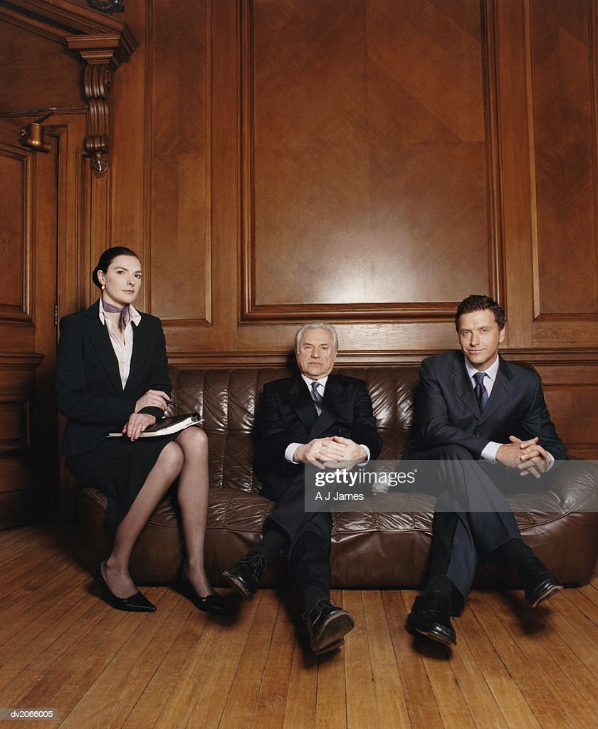 Portrait of Two Businessmen and a Businesswoman : Stock Photo