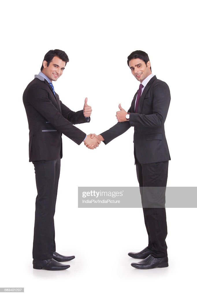 Portrait of two businessmen giving thumbs up : Stock Photo