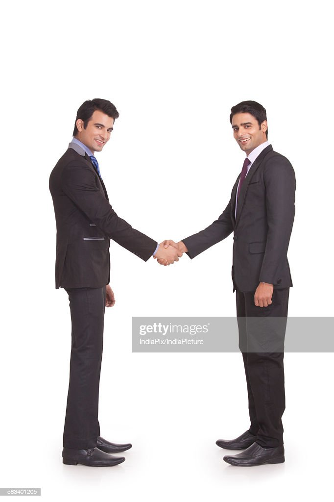 Portrait of two businessmen shaking hands : Stock Photo