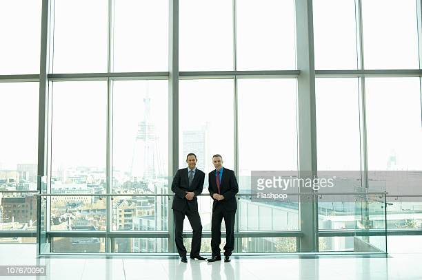 portrait of two businessmen smiling - abbigliamento da lavoro formale foto e immagini stock