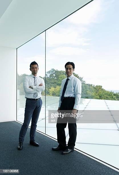 Portrait of two businesswomen in office hallway