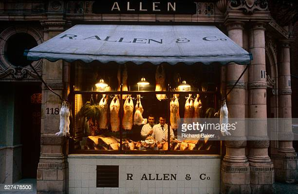 A portrait of two butchers standing in the window of R Allen Co Mayfair London the oldest and finest butchers in the capital It is dawn one morning...