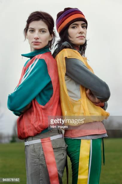portrait of two caucasian women who play sports outside in the winter. - chándal fotografías e imágenes de stock