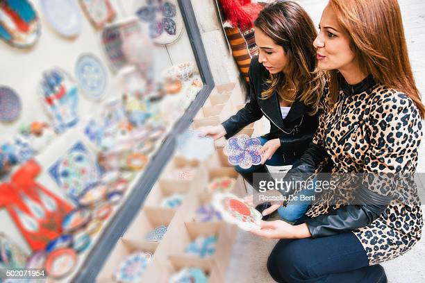 Portrait Of Two Cheerful Woman Buying Pottery