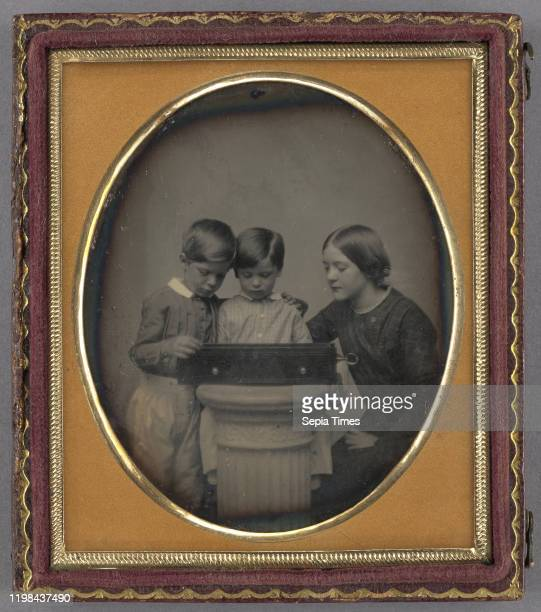 Portrait of Two Children and Their Mother Viewing a Music Box; American; about 1851; Daguerreotype.
