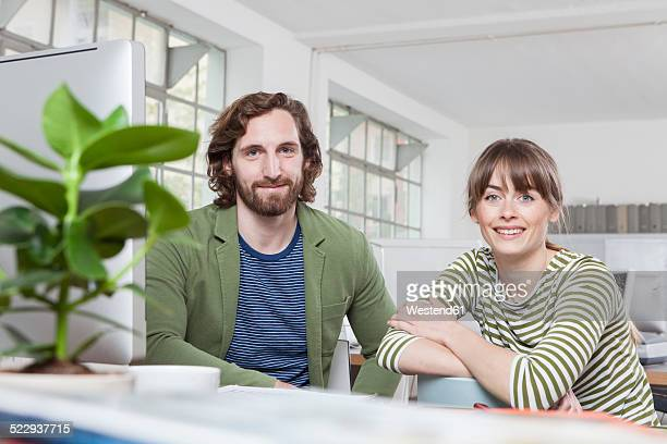 Portrait of two colleagues in a creative office