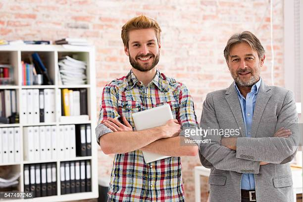 Portrait of two confident businessmen in office
