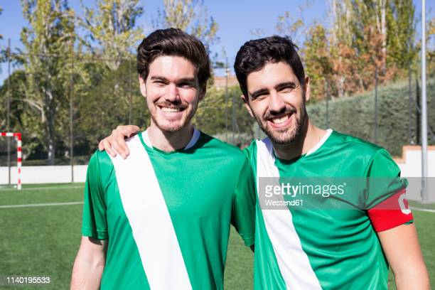 portrait of two confident football players on football field - team captain stock pictures, royalty-free photos & images