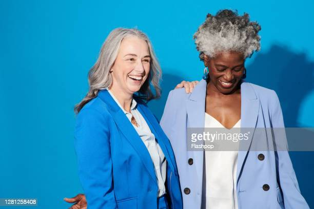 portrait of two confident, successful professional women - coworker stock pictures, royalty-free photos & images