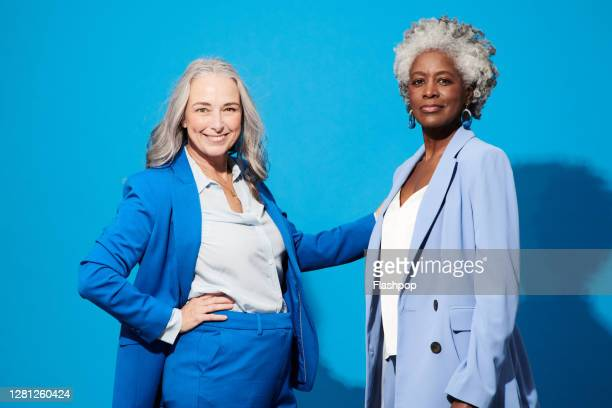 portrait of two confident, successful professional women - studio shot stock pictures, royalty-free photos & images