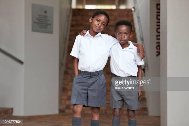 Portrait of two cool school boys in uniforms