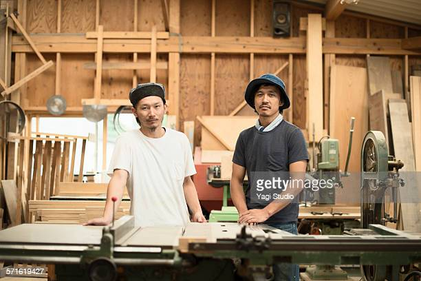 Portrait of two craftsmen in workshop