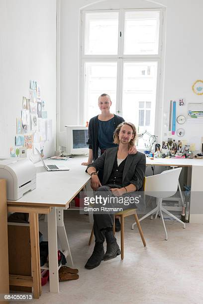 Portrait of two creative business people in office