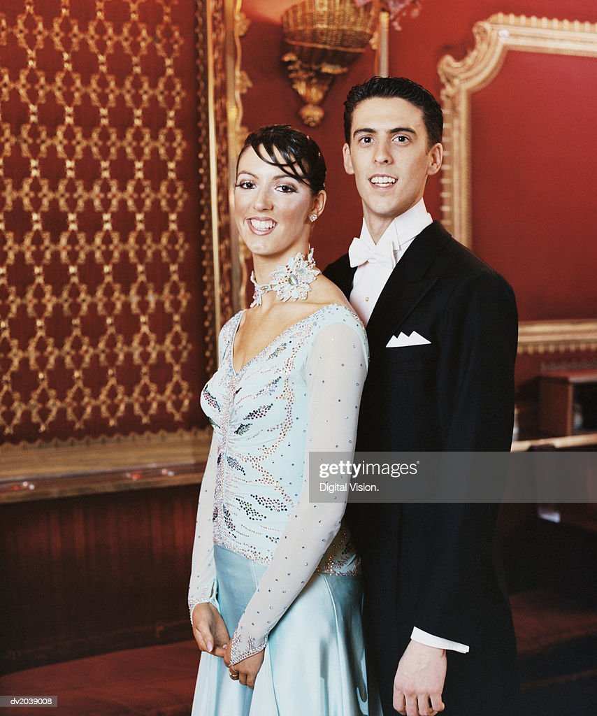 Portrait of Two Elegantly Dressed Ballroom Dancers Standing Together : Stock Photo