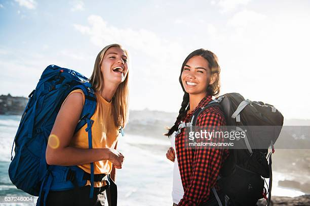 Portrait of two female backpackers outdoors