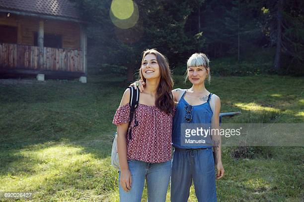 Portrait of two female friends in forest, Sattelbergalm, Tyrol, Austria